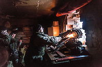 "UKRAINE, 03.2015, Peski. In dem umkaempften Dorf unweit des Donezker Flughafens schiessen Kaempfer des ""Rechter Sektor"" Freiwilligenbataillons mit dem automatischen Granatwerfer AGS-17.   In the frontline village close to the Donetsk airport fighters of the ""Right Sector"" volunteer battalion are shooting with the automatic grenade launcher AGS-17.  © Arturas Morozovas/EST&OST"