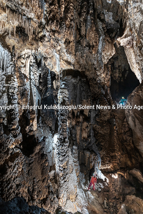 Pictured:  Kemikli Cave, Mihalıçcık, Eskişehir Turkey.<br /> <br /> A team of explorers venture through a series of incredible caves filled with huge stalagmites and underwater lakes.<br /> <br /> The adventurers are carrying out tests in the subterranean world to work out how old the caves are and how they were formed.<br /> <br /> The intriguing images were captured in caves across Turkey by amateur photographer Ertuğrul Kulaksizoglu.   SEE OUR COPY FOR FULL DETAILS.<br /> <br /> <br /> Please byline: Ertugrul Kulaksizoglu/Solent News<br /> <br /> © Ertugrul Kulaksizoglu/Solent News & Photo Agency<br /> UK +44 (0) 2380 458800