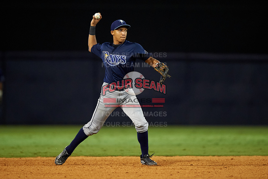 Luis Curbelo (18) of Puerto Rico Baseball Academy in Carolian, Puerto Rico playing for the Tampa Bay Rays scout team during the East Coast Pro Showcase on July 29, 2015 at George M. Steinbrenner Field in Tampa, Florida.  (Mike Janes/Four Seam Images)