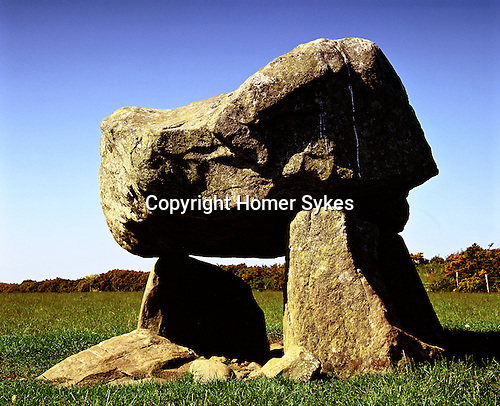 """Llech y Drybedd, Nr Molygrove, Pembrokshire Wales. Uk Celtic Britain published by Orion. Translates into English as the """"Stone of Three Graves"""". Squat burial chamber all that remains of a prehistoric Neolithic Long Barrow."""