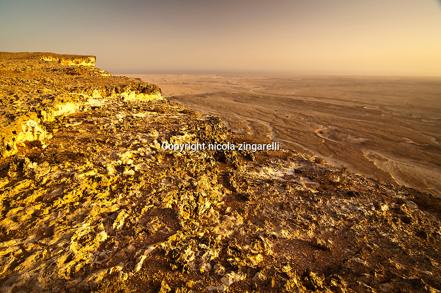 view of the edge of the shuwaymiyah plateau in southern oman taken from the very cliff