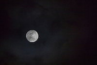 A break in the clouds provides a glimpse of the 2017 Full Wolf Moon.