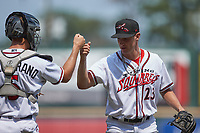 Richmond Flying Squirrels relief pitcher R.J. Dabovich (23) bumps fists with catcher Brandon Martorano (5) following their win over the Bowie Baysox at The Diamond on July 28, 2021, in Richmond Virginia. (Brian Westerholt/Four Seam Images)