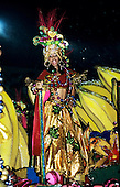 Rio de Janeiro, Brazil. Carnival samba school parade; woman in bright multicoloured metallic costume