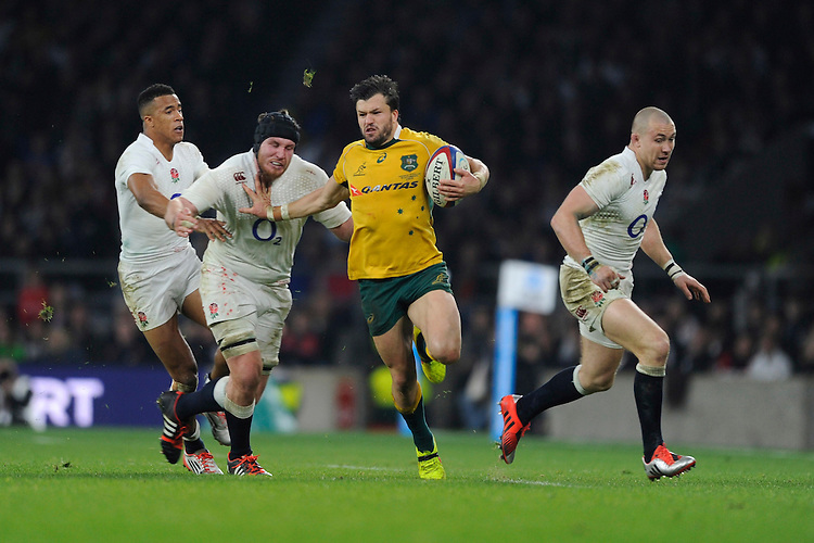 Adam Ashley-Cooper of Australia hands off Ben Morgan of England during the QBE International match between England and Australia at Twickenham Stadium on Saturday 29th November 2014 (Photo by Rob Munro)