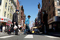 NEW YORK - NEW YORK - MARCH 21: People cross a street in Chinatown on March 21, 2021 in New York. In the last two months, more than 500 attacks on Asians have been reported in United States. (Photo by John Smith/VIEWpress)