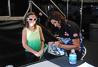 Jul, 8, 2011; Joliet, IL, USA: NHRA funny car driver Melanie Troxel signs autographs for a young fan during qualifying for the Route 66 Nationals at Route 66 Raceway. Mandatory Credit: Mark J. Rebilas-