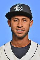 Asheville Tourists infielder Carlos Herrera (4) poses for a photo at Story Point Media on April 5, 2016 in Asheville, North Carolina. (Tony Farlow/Four Seam Images)