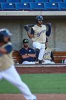 AZL Brewers Gold Andres Melendez (22) watches an at bat during an Arizona League game against the AZL Brewers Blue on July 13, 2019 at American Family Fields of Phoenix in Phoenix, Arizona. The AZL Brewers Blue defeated the AZL Brewers Gold 6-0. (Zachary Lucy/Four Seam Images)