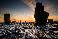 Sunset over rock formations near Rapahoe near Greymouth, West Coast, New Zealand