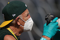 OAKLAND, CA - SEPTEMBER 20:  Oakland Athletics team photographer Michael Zagaris works while wearing a mask and gloves during the game against the San Francisco Giants at the Oakland Coliseum on Sunday, September 20, 2020 in Oakland, California. (Photo by Brad Mangin)