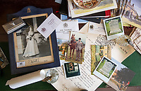 BNPS.co.uk (01202 558833)<br /> Pic: PhilYeomans/BNPS<br /> <br /> Thomas's bureau contain's reminders of his Royal life..<br /> <br /> A remarkable 'timewarp' archive amassed by a dressmaker to the Queen has sold for over £100,000.<br /> <br /> The late Ian Thomas meticulously kept his fashion designs, letters, cards and photographs relating to the Queen at his home that was more like a museum. <br /> <br /> He helped design the Queen's coronation gown in 1953 as well as the powder blue outfit she wore for Charles and Diana's wedding in 1981.<br /> <br /> The lifelong bachelor passed away in 1993 and left his home and its contents to a florist he had been good friends with for 25 years.<br /> <br /> After she died in 2015 the property was inherited by a relative who also knew Mr Thomas well.<br /> <br /> She has now sold the contents at auction.