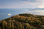 Greece, Corfu, near bei Rou: View over Corfiot landscape to bay and Corfu Town with cruise ship