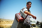Libyan rebel with a looted accordian in the town of Qwaleesh, Western Libya. ..Photog: Ayman Oghanna