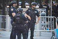 NYPD officers provide security on the 20th anniversary of the September 11, 2001 terrorist attack on the World Trade Center and the Pentagon in New York, New York, on Saturday, September 11, 2021.<br /> CAP/MPI/RS<br /> ©RS/MPI/Capital Pictures