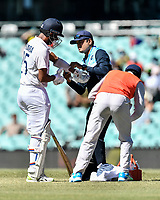 11th January 2021; Sydney Cricket Ground, Sydney, New South Wales, Australia; International Test Cricket, Third Test Day Five, Australia versus India; Cheteshwar Pujara of India  receives treatment on his arm