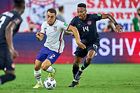 5th September 2021; Nashville, TN, USA;  United States defender Sergino Dest challenges Canada midfielder Mark-Anthony Kaye (14) during a CONCACAF World Cup qualifying match between the United States and Canada on September 5, 2021 at Nissan Stadium in Nashville, TN.