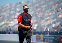 Aug 8, 2020; Clermont, Indiana, USA; Crew member for NHRA top fuel driver Steve Torrence during qualifying for the Indy Nationals at Lucas Oil Raceway. Mandatory Credit: Mark J. Rebilas-USA TODAY Sports