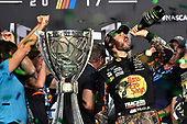 Monster Energy NASCAR Cup Series<br /> Ford EcoBoost 400<br /> Homestead-Miami Speedway, Homestead, FL USA<br /> Sunday 19 November 2017<br /> Martin Truex Jr, Furniture Row Racing, Bass Pro Shops / Tracker Boats Toyota Camry celebrates winning the 2017 Monster Energy Cup Series Championship <br /> World Copyright: Nigel Kinrade<br /> LAT Images
