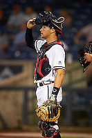 Mississippi Braves catcher Matt Kennelly (14) during a game against the Pensacola Blue Wahoos on May 27, 2015 at Trustmark Park in Pearl, Mississippi.  Pensacola defeated Mississippi 7-5 in fourteen innings.  (Mike Janes/Four Seam Images)