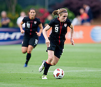 Heather O'Reilly (9) of the USWNT carries the ball upfield during the game at WakeMed Soccer Park in Cary, NC.   The USWNT defeated Japan, 2-0..