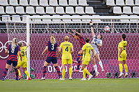 KASHIMA, JAPAN - AUGUST 5: Teagan Micah #18 of Australia stretches for a ball during a game between Australia and USWNT at Kashima Soccer Stadium on August 5, 2021 in Kashima, Japan.