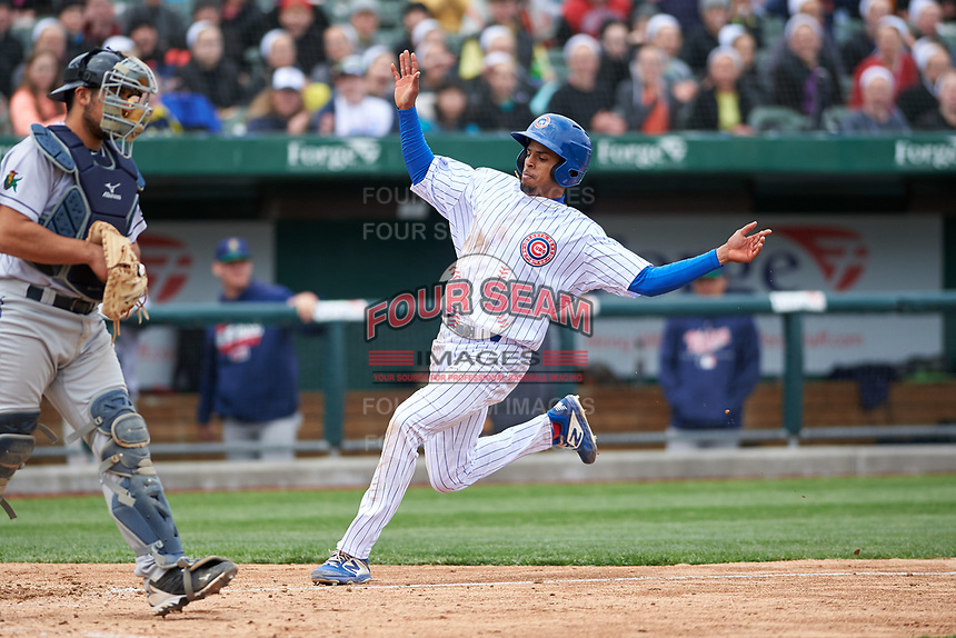 South Bend Cubs third baseman Christopher Morel (29) slides across home plate to score the winning run during a Midwest League game against the Cedar Rapids Kernels at Four Winds Field on May 8, 2019 in South Bend, Indiana. South Bend defeated Cedar Rapids 2-1. (Zachary Lucy/Four Seam Images)
