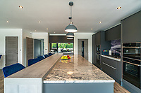 BNPS.co.uk (01202 558833)<br /> Pic: ShorePartnership/BNPS<br /> <br /> Pictured: The kitchen.<br /> <br /> A brand new waterfront home perfect for paddleboarders is on the market for £1.3m.<br /> <br /> Creek View is built on a former boatyard and has direct water access to Restronguet Creek from steps in the back garden.<br /> <br /> The contemporary four-bedroom house has an open-plan living space and floor-to-ceiling glass overlooking the water to make the most of its stunning location.