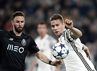 Juventus' Marko Pjaca, right, is challenged by Porto's Miguel Lyun during the Champions League round of 16 soccer match against Porto at Turin's Juventus Stadium, 14 March 2017. Juventus won 1-0 (3-0 on aggregate) to reach the quarter finals.<br /> UPDATE IMAGES PRESS/Isabella Bonotto