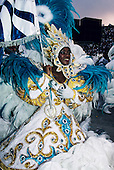 Rio de Janeiro, Brazil. Carnival; young woman standard bearer in tourquoise and white sequined costume, dancing. Sapucai.