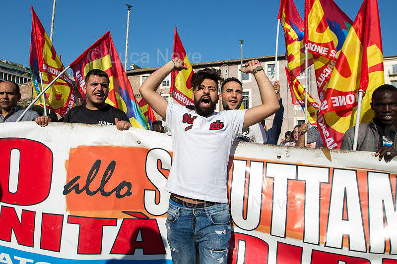 """Rome, 20/10/2018. Today, Potere al Popolo & Unione Sindacale di Base USB, amongst others, held the National demonstration """"In Piazza Contro il Governo dell'Odio! Per il Reddito, il Lavoro e le Nazionalizzazioni"""" (Taking the square against the Government of Hate! For [proper] Wage, Work and Nationalization), which saw thousands of people (10,000+ people for the organisers) marching peacefully from Piazza della Repubblica (Repubblica's Square) to Piazza San Giovanni in Laterano (San Giovanni's Square). The Protest - which marked the International Week for Nationalizations - was called """"to defend territory, services, healthcare, work, and to make heard the voices of the people who paid the crisis with the rise of exploitment, tariffs, and pollution: Nationalise here and now!"""" (Source – organisers Facebook page event). The demonstration ended in Piazza San Giovanni where  political leaders, the Mayor of Riace Mimmo Lucano (via mobile phone), a delegation of workers from Genova - city which was recently hit by the disaster of the Morandi's Bridge where 43 people were killed -, workers of Alitalia & ILVA, and students gave speeches.  <br /> <br /> For more info please click here: https://www.facebook.com/events/686774911715885/<br /> & https://poterealpopolo.org/ & http://www.usb.it/<br /> <br /> For my Story: 16.06.2018 - USB: Basta Disuguaglianze! (Stop Inequalities) – Justice for Soumaila Sacko: https://bit.ly/2Q0BLAA"""