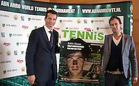 12-01-12, Tennis, Amsterdam, ABNAMRO Hoofdkantoor, Als gast hoofdredacteur van het eerste nummer van het blad Tennis het Magazine krijgt toernooi directeur Richard Krajicek de eerste cover aangeboden van de hoofdredacteur Steffan Kok(R)
