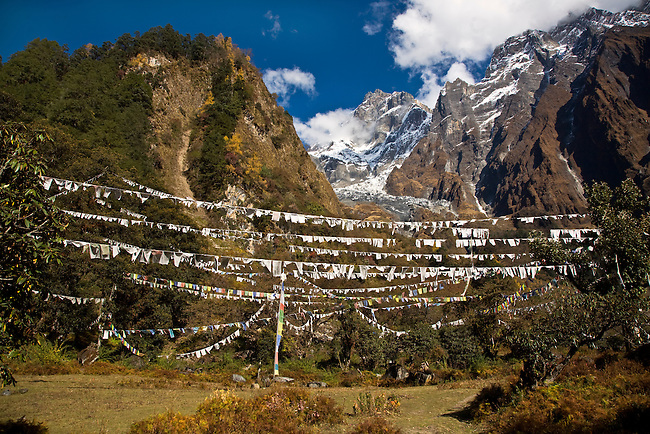 A field of PRAYER FLAG below peaks at a remote TIBETAN BUDDHIST MONASTERY - NEPAL HIMALAYA