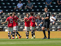 18th July 2021; Pride Park, Derby, East Midlands; Pre Season Friendly Football, Derby County versus Manchester United;  Facundo Pellistri of Manchester United (Second from the right) is congratulated by Shola Shoretire of Manchester United and Jesse Lingard is congratulated by  Andreas Pereira for making the pass to him. Pellistri scored in the 59th minute to make it 2-0