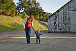 Kristy guiding Caleb while practicing walking, San Luis Obispo, California
