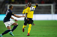 ORLANDO, FL - JULY 20: Oniel Fisher #8 of Jamaica dribbles the ball during a game between Costa Rica and Jamaica at Exploria Stadium on July 20, 2021 in Orlando, Florida.
