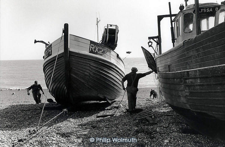 Fishermen on Hastings beach (The Stade), home to the largest beach-launched fishing fleet in the UK.