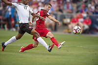 Commerce City, CO - Thursday June 08, 2017: Mekeil Williams, Christian Pulisic during a 2018 FIFA World Cup Qualifying Final Round match between the men's national teams of the United States (USA) and Trinidad and Tobago (TRI) at Dick's Sporting Goods Park.