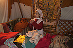 A girl sells robes at the Journey to Bethlehem Living Nativity reenactment at Journey of Faith Baptist Church in Manhattan Beach, CA