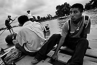 A Central America immigrant, sitting on a inner tube raft, crosses the Suchiate river from Tecún Umán, Guatemala, to Mexico, 22 May 2011. Having no migration or commercial controls, the Suchiate river serves as an illegal crossing point between the southern Mexican state of Chiapas and Guatemala. Every day, hundreds of people from both countries, crossing the river on the unstable rafts called ?camaras?, smuggle soft drinks, toilet papers, fruits, vegetables and other supplies. The river crossing is also widely used by the Central America immigrants heading to the north, to the United States, in the search of better life.