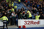 Hibs fans celebrate the opening goal at Ibrox