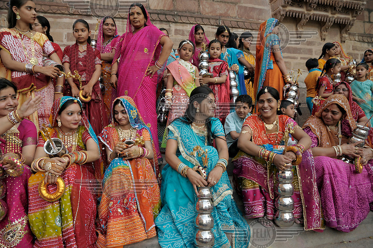 Women gather for a ceremony marking the installation of an idol.