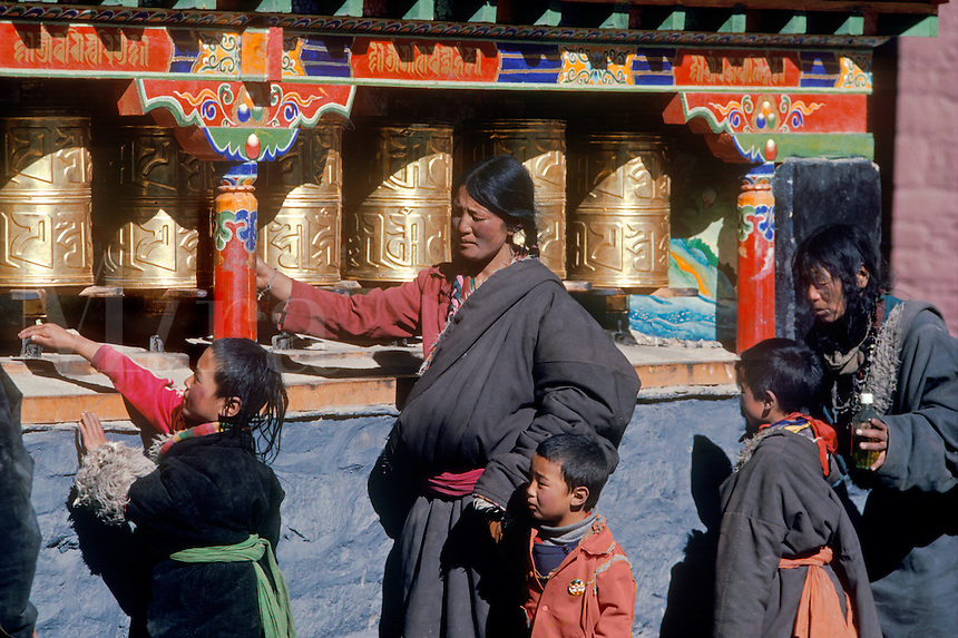 Pilgrims spin prayer wheels at Sakya Monastery - Sakya, Tibet.