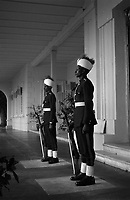 Two guards in black uniforms with headdress and rifles at the Presidential Palace (former Governor-General's Palace) - Khartoum, Sudan,NOV 1961