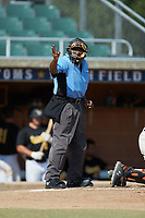 Home plate umpire Marcus Neal makes a strike call during the game between the Statesville Owls and the High Point-Thomasville HiToms at Finch Field on July 19, 2020 in Thomasville, NC. The HiToms defeated the Owls 21-0. (Brian Westerholt/Four Seam Images)