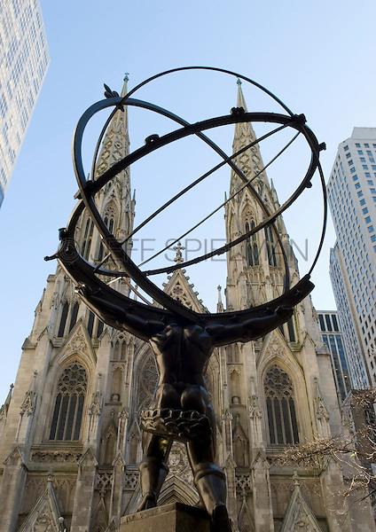 Bronze Statue of the Mythological Greek Titan Atlas (Designed by Lee Lawrie in 1937) at Rockefeller Center with Saint Patrick's Cathedral on Fifth Avenue in Background, Midtown Manhattan, New York City, New York State, USA