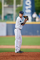 Lake County Captains relief pitcher Skylar Arias (9) gets ready to deliver a pitch during the first game of a doubleheader against the South Bend Cubs on May 16, 2018 at Classic Park in Eastlake, Ohio.  South Bend defeated Lake County 6-4 in twelve innings.  (Mike Janes/Four Seam Images)