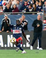 FOXBOROUGH, MA - SEPTEMBER 11: Emmanuel Boateng #11 of New England Revolution passes the ball during a game between New York City FC and New England Revolution at Gillette Stadium on September 11, 2021 in Foxborough, Massachusetts.