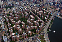 aerial photograph of Stuyvesant Town–Peter Cooper Village, Manhattan, New York City; FDR Drive and the East river in the foreground