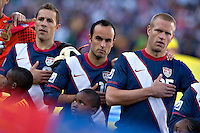 Steve Cherundolo (left) Landon Donovan (centre) and Jay De Merit (right) of USA during the national anthems before the game against Slovenia